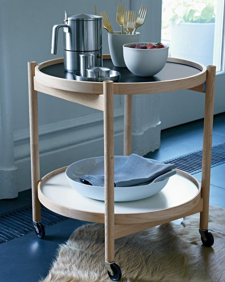 The Bølling Tray Table is a practical table with many functions. Can be used as a side table nightstand coffe table in front of sofa or serving table like in this picture. It is easy to fold and store. Designed to make life at home more flexible and personal. #brdrkrüger #bøllingtraytable #hansbølling #interiordesign #interiorlovers #madeindenmark #scandinaviandesign #inspiration #homedecor