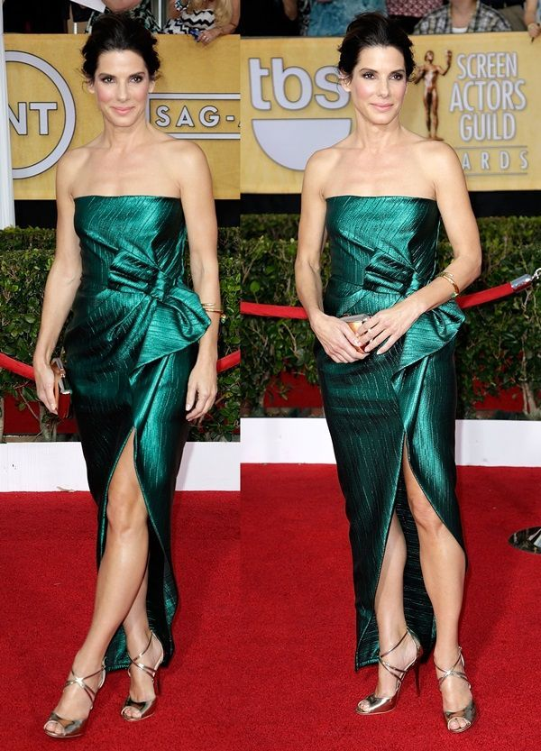Sandra Bullock styled a strapless emerald green gown by Lanvin with a metallic Roger Vivier Boite de Nuit clutch and a simple gold bangle by Fred Leighton #rogervivierpumps