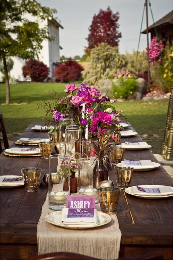 elegant outdoor reception table decor #purpleweddingflowers #familystyleseating #weddingchicks http://www.weddingchicks.com/2014/01/14/deep-purple-wedding/
