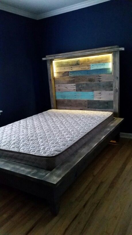 Pallet headboard and platform bed with LED lights hidden in headboard