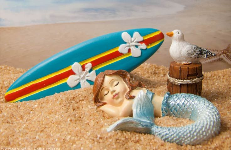 Surf the miniature fairy garden beach.
