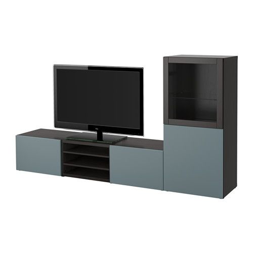 IKEA - БЕСТО, Шкаф для ТВ, комбин/стеклян дверцы, черно-коричневый/Вальвикен серо-бирюзовый, прозрачное стекло, направляющие ящика, плавно закр, , Благодаря доводчикам ящики и дверцы закрываются плавно и бесшумно.Благодаря нескольким отверстиям на задней панели тумбы под ТВ провода от телевизора и других устройств всегда будут под рукой, но не на виду.Специальное отверстие в верхней панели обеспечит удобное и компактное размещение проводов.Два ящика и полки за дверцами обеспечат до...