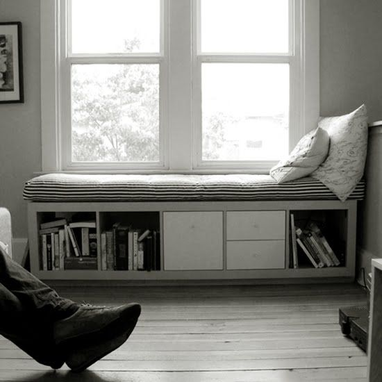 ikea bookshelf with reused futon - into great window seat! I could see putting casters on this too and making a rolling bench storage.