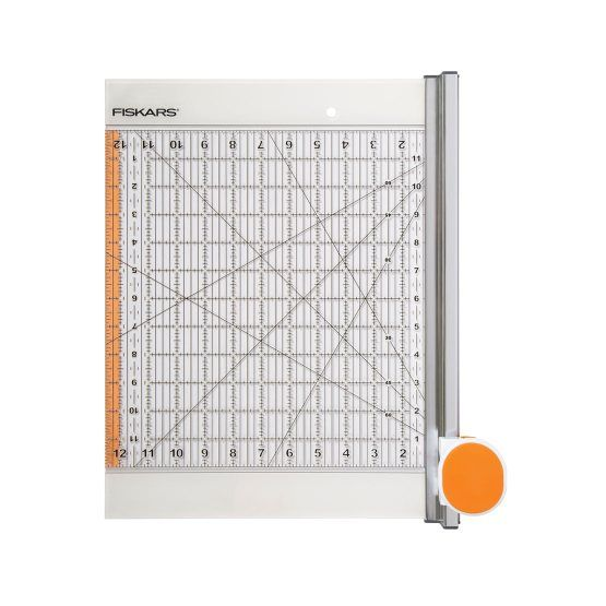 """Ideal for measuring and making clean, precise cuts through fabric when cutting shapes, the 12"""" x 12"""" Rotary Cutter and Ruler Combo is a terrfic choice for the quilter on your list."""