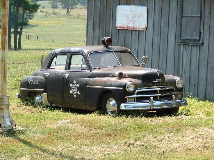 Old Police Car near Old Service Station, somewhere near Buffalo River, Arkansas. Looks like an early 50's Plymouth..