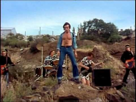"""The music video for """"Jailbreak"""" was filmed in March 1976 for the Australian music programme Countdown, and was directed by Paul Drane. It was filmed in a quarry in the Melbourne suburb of Footscray and featured the band's then-current lineup. Phil Rudd and Bon Scott dressed as prisoners (blue uniform covered with typical Australian Broad Arrow),..."""