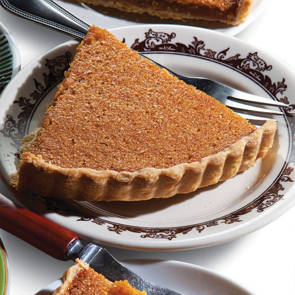 Inside a buttery shortbread crust, a molten goo of golden syrup is brightened by aromatic lemon zest in this Alice's tea party-worthy treacle tart.
