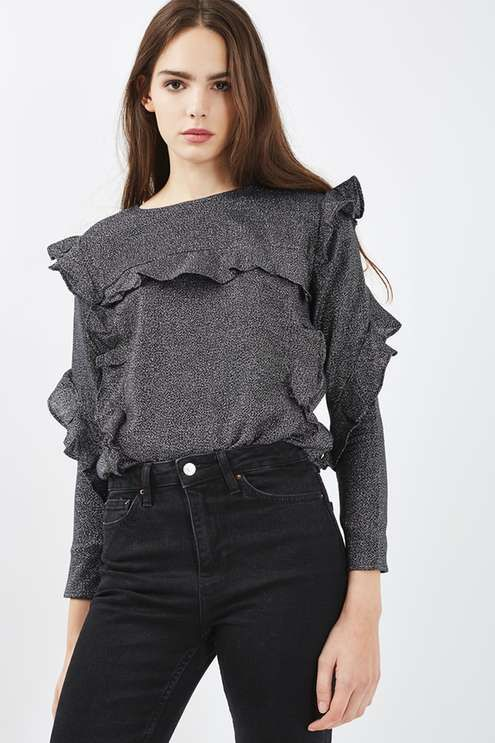 Romantic ruffles are this season's favourite feature. We love them on this metallic blouse, detailed on the bodice and throughout the sleeves. Tuck into high waisted black jeans for a girlie-casual look. #Topshop
