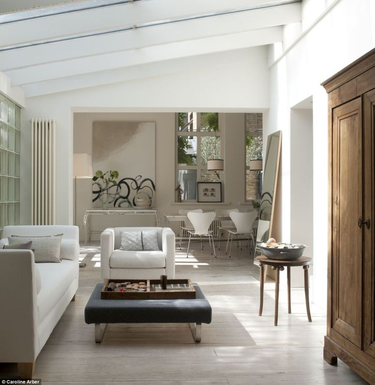 Minimalist: This glass-roofed passage connects the main sitting and dining rooms and is used as a second living area.