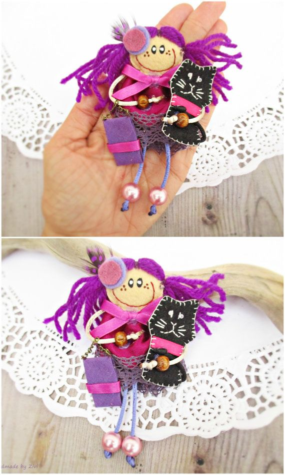 Doll Brooch For Girl, Doll With Black Cat, Small Cloth Doll, Personalized Dolls, Doll With Purple Dress, Miniature Doll, Gift For Girl  Purple brooch doll with black cat.  Smug and sympathetic Sandra with purple dress and black little cat.  Used materials: felt, fabric, lace, seed beads and beads, yarn, cloth. Colors: purple, hot pink, black Doll size: 4.23-5.1 in. (12-13 cm.) Each doll is completely handmade and is unique.  I am a very coquette doll I like handbags, earrings, headdresses…