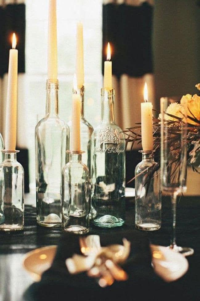 13 Festive Decorating Tricks Trending On Pinterest Right Now Wine Bottle Candles Wine Bottle Centerpieces Wine Bottle Candle Holder