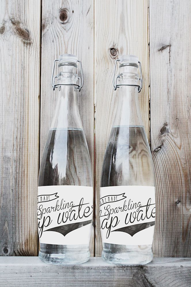 White washed wood with cute bottles for the kitchen...would look great with the black cabinets and gray/white stripe linens http://www.bottleyourbrand.com/water-bottle-labels
