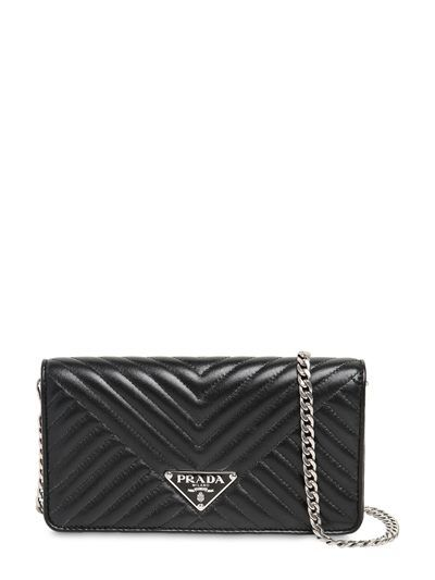 c31bd93ad031 Front flap with snap button closure. Logo detail. Internal card slots. Logo  lining. PRADA, Quilted nappa leather chain shoulder bag ...