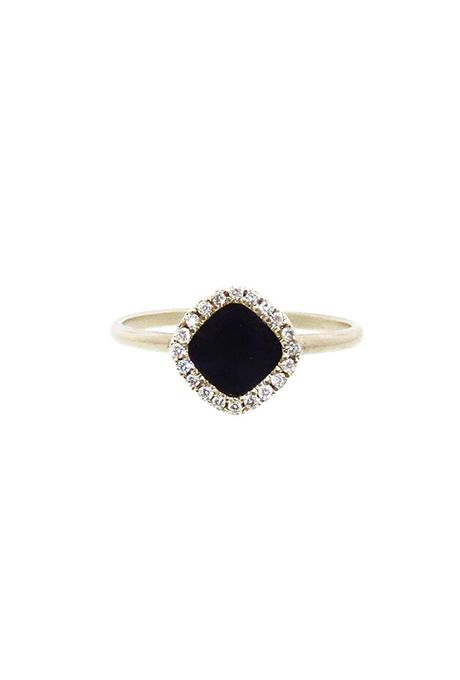 Brides.com: . Black Guatemalan jade engagement ring with white diamond halo set…