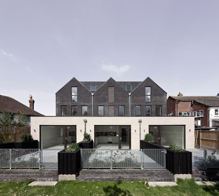London studio Denizen Works has completed a block of apartments in the English seaside town of Whitstable.