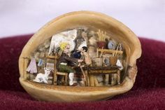 Pinnochio sculpture in a a walnut shell by Pascale Casarosa