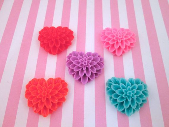 These are large heart flower cabochons. They are 33mm long, 38mm wide, and 13mm thick. and come in 5 different colors; red, orange, blue, purple and pink. They are flatback and made of resin. You can pick the amount you would like to purchase in the drop down menu and you will get a mix of the colors in stock