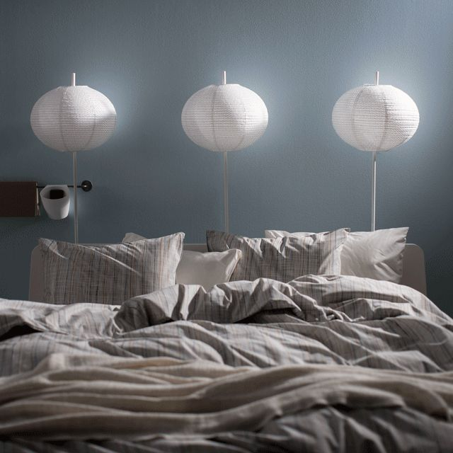 A GIF of lamps above a bed turning on in sequence