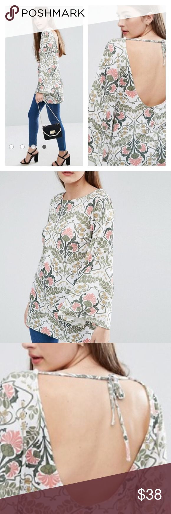 ASOS TOP W/BELL SLEEVES AND OPEN BACK TILE PRINT ASOS smooth knit fabric with rounded neckline,fluted sleeves and a open keyhole back with tie fastening. Relaxed fit. Material: 95% Polyester 5% elastane.  Machine wash ASOS Tops Tunics