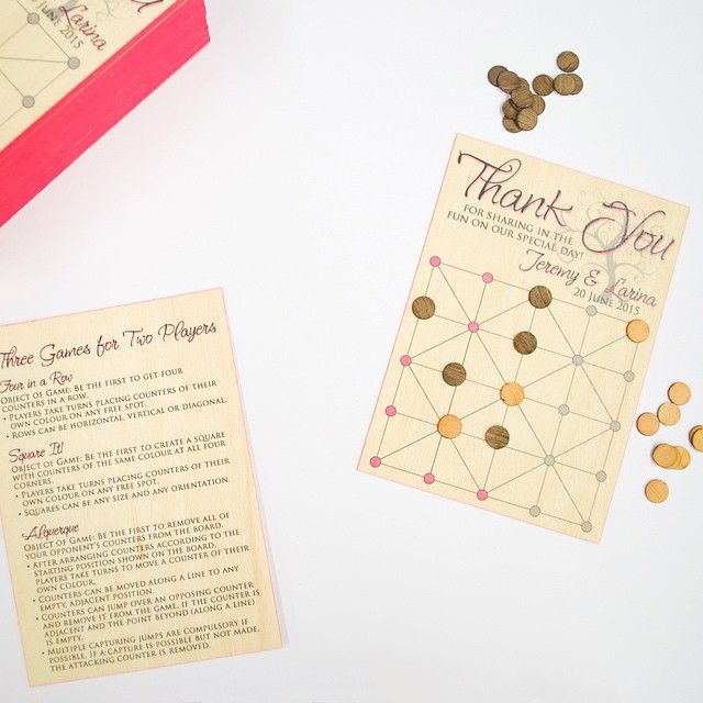 We love the idea of creating a board game to be put on tables at a wedding. This one was printed onto #birchwood with pink edge painting. We laser cut circle pieces so guests could play throughout the night.  #print #wedding #printonwood