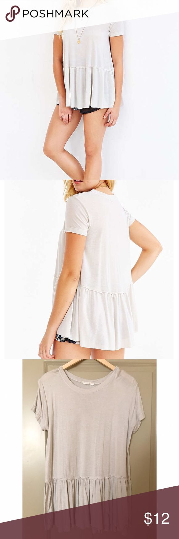 Urban Outfitters Raw-Edge Peplum Top Truly Madly Deeply from Urban Outfitters, Raw-cut Short Sleeve peplum top in Ivory. Darker in color than stock photos, more of a cream color. Urban Outfitters Tops Tees - Short Sleeve