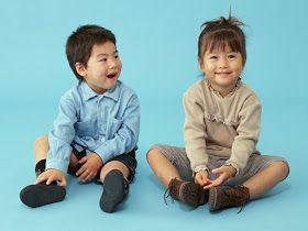 NAMC young montessori class behavioral challenges circle time young boy and girl sitting