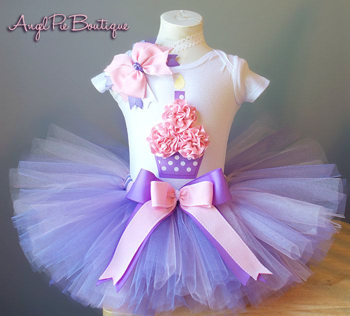 Baby Girl's First Birthday Outfit - Cupcake Onesie, Tutu and Matching Headband - Lavender and Baby Pink. $51.99, via Etsy.