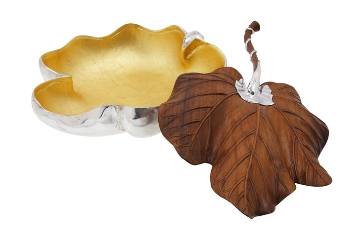 The brushed sterling silver bowl interior is finished with real 24K gold leaves to add a luxurious touch. Long silver leaf stem is thoughtfully designed to rest beautifully on the bowl. This piece adds a distinctive touch of nature to any place around the house.  It took 4 craftsmen more than 3 months to finish this piece.