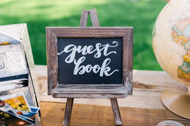 A wedding guest book is yet another seemingly unnecessary item on your never-ending wedding to-do list. Here's what you need to know… #weddingguestbook #weddingideas