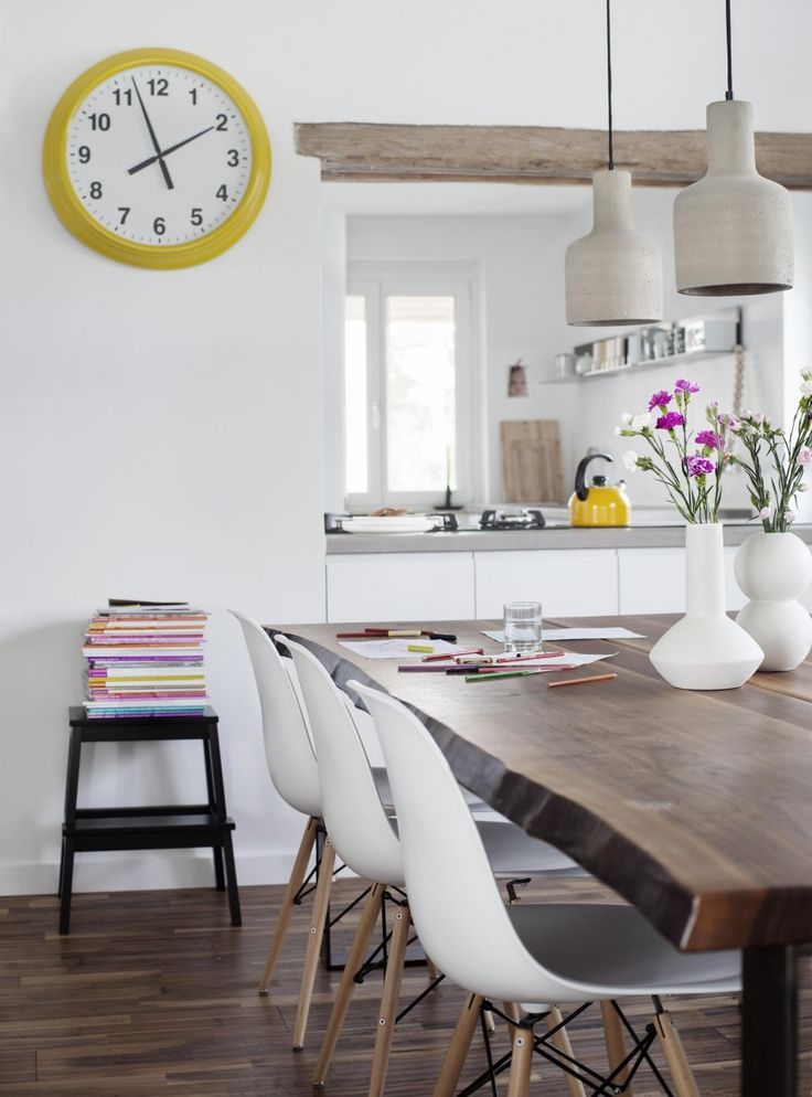Dining room with industrial chairs, concrete lamps en a yellow clock on the wall | Styling & Photography by Christine Bauer | vtwonen August 2015