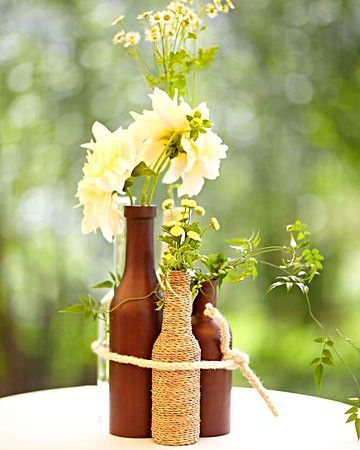 spray painted bottles and covered in twine. cute cluster.Ideas, Rustic Centerpieces, Bottle Centerpieces, Beer Bottles, Wine Bottles, Flower, Winebottle, Center Pieces, Diy Centerpieces