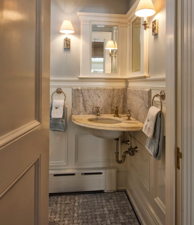 Small bathroom - Corner mirror design. Love it! And the corner sink ...