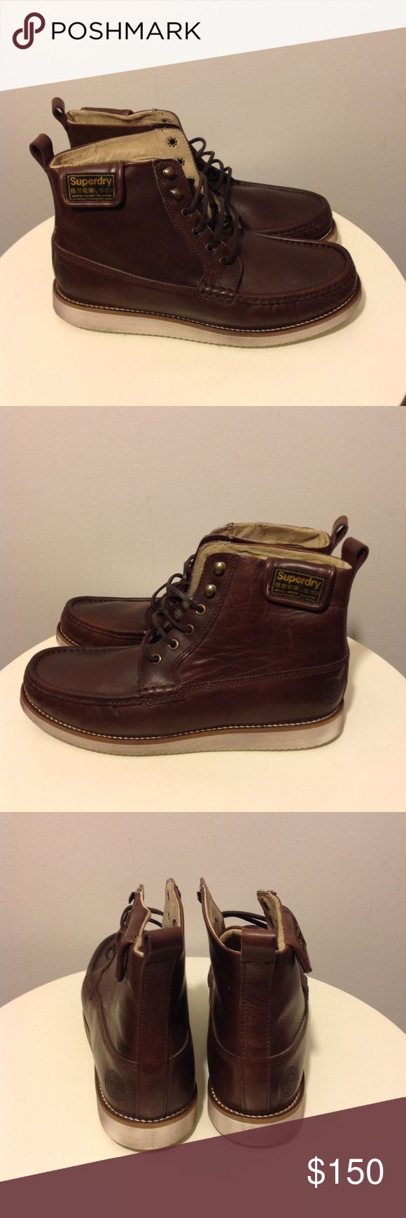 Superdry Leather Trapper Boots Men's Sz 10/44 Great pre-owned condition  Leather ankle boots in brown Eyelet and speed lace fastening Fold over ankle patch with snaps Contrast manmade sole Embossed heel logo Men's size 10 US / EU 44 Superdry Shoes Chukka Boots