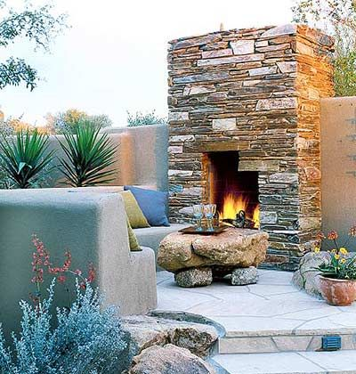 outdoor fireplace, stone table
