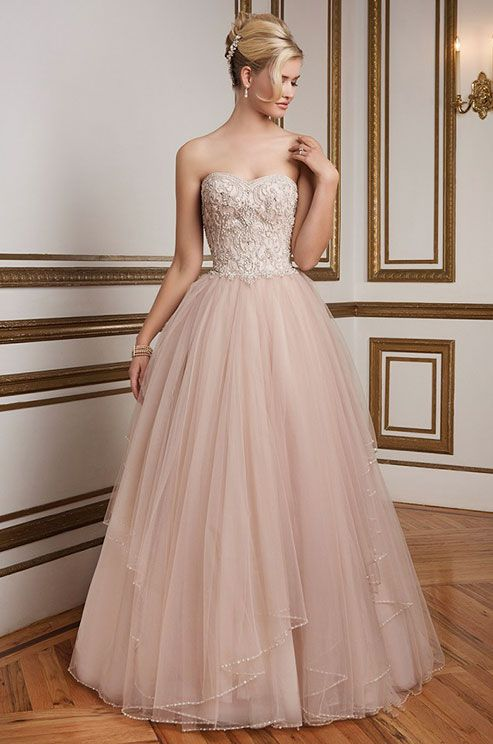 Sweetheart beaded bodice, natural waistline and tulle ball gown skirt with tiers of beaded trim. A classic, elegant wedding dress rich in color. Justin Alexander, Spring 2016