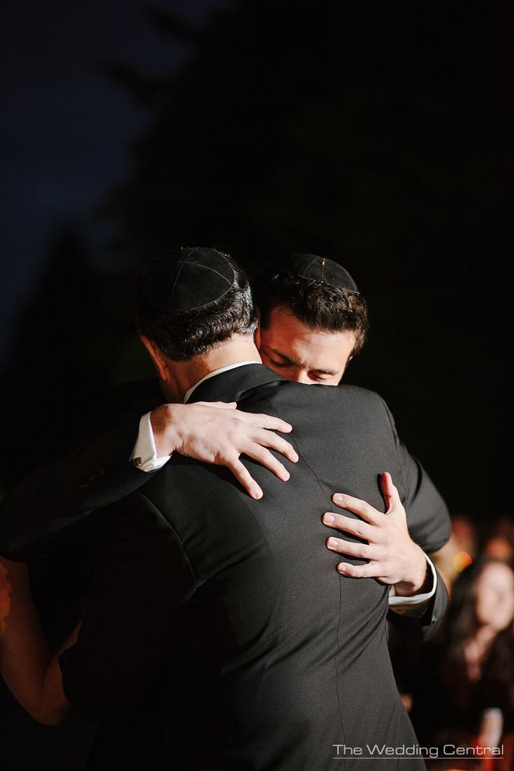 The Hug - Father and son hug as groom arrives at to the altar #JewishWedding #NYWeddingPhotos ~www.theweddingcentral.com