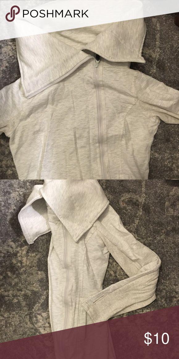 Beige zip up sweatshirt Long length zip up beige sweatshirt. With rib knit sides Mondetta Tops Sweatshirts & Hoodies