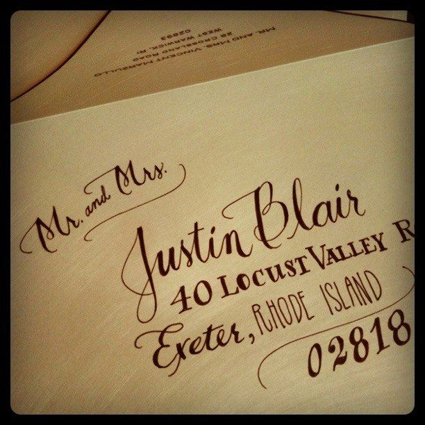 Some hand-addressed envelopes in pen and ink on shimmer paper with black edging
