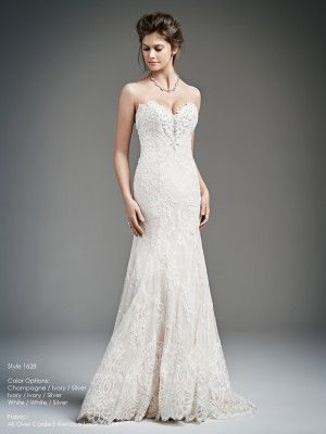 1628 by Kenneth Winston. This all over corded alencon lace and satin gown has a beautifully beaded bust and low back. fastened with satin buttons this gown fits comfortably to the shape of your body. With colour options of Champagne/Ivory Silver, Ivory/Ivory/Silver and White/White/Silver.