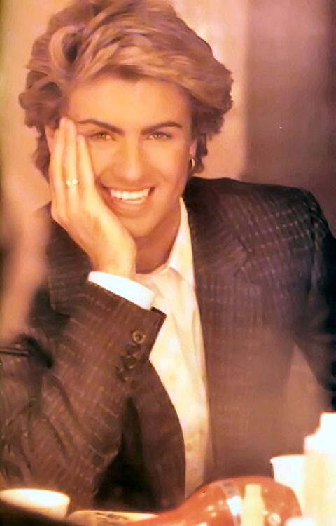 George Michael... those eyebrows doh...