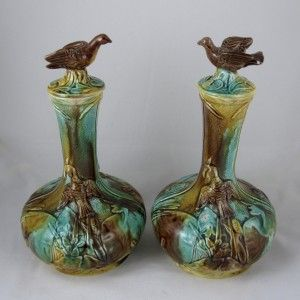 A scarce pair of unusual bulbous majolica bottles with bird finials on domed lids, Thomas Forester & Sons, Longton, Staffordshire, England – Circa 1870-1880. A mottled tortoise shell glaz…