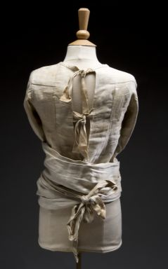 Canvas straitjacket for adults, London, England, 1930-1960. This straitjacket restrained adult patients in psychiatric hospitals during the 1930s through to the 1960s. It is made of heavy canvas. It has four ties on the main body and excessively long arms. These wrap around and tie behind the back. Such garments restricted the movements of patients considered violent or unruly. Their use was phased out when anti-psychotic drugs and more 'humane' methods of management were introduced.