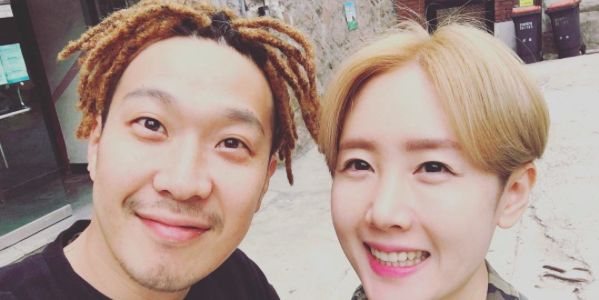 """On June 5, Haha posted a picture on his personal Instagram account with the caption, """"Young married couple cosplay~!! Got [our] hair done~~ ^.~ cordyceps [a type of fungus that Haha's hair resembles] upgrade!! Ya man~~!! Ya man~~!!!!"""". In the photo Haha and Byul take a series of cute selfies togethe..."""