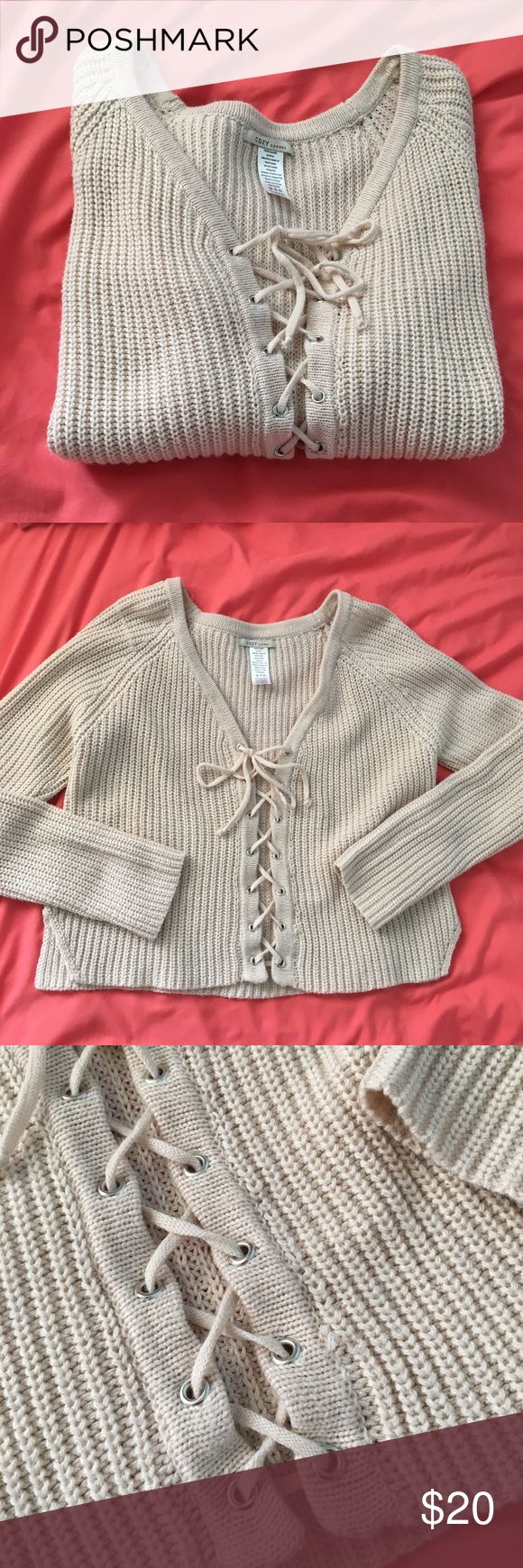 Cute Beige Lace up knot sweater Perfect for the spring! And lounging around. Has little pilling on it due to nature of fabric. Size is small/medium, can be adjusted. But over all still good condition! Didn't wear it much just didn't look as good on me as I hoped. It's a random online boutique brand. 🛑➡️ NOT Urban outfitters ! Using for exposure Urban Outfitters Tops Sweatshirts & Hoodies