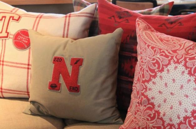 Adding old varsity letters to pillows says vintage instantly. Would be a great way to repurpose mom or dad's high school letters too.