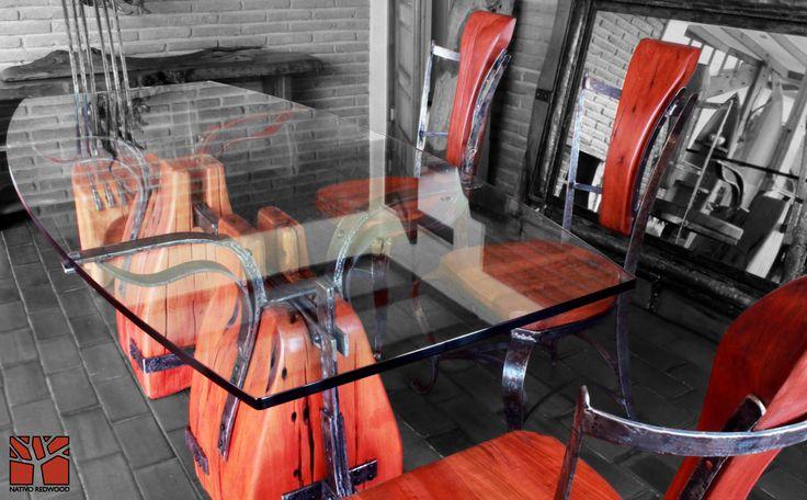 Nativo Redwood. Mesa de comedor con base de maderos de una pieza de roble rústico con forma de lomo de caballo con flejes de fierro forjado como correas de cuero, con cubierta de cristal con forma de almendra de 0.80-1.00x2.00x19 mm espesor. www.facebook.com/nativoredwoodsa