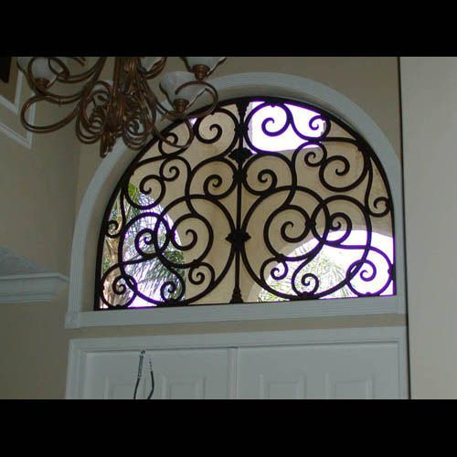 Love this wrought iron for the half moon windows in the secondary bedrooms