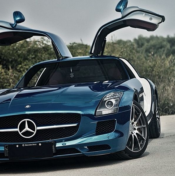 That is the nicest metallic paint on a car! Gullwings baby! Sexy Mercedes SLS AMG. Hot or Not? #TinderForCars