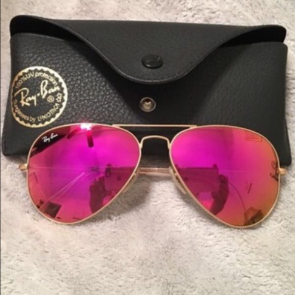 Brand new Ray ban aviator purple/pink Purple pink authentic Ray ban,have insignificant colorless in the corner you can't see it,very cute sun glasses  Ray-Ban Accessories Glasses