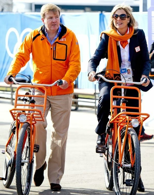 Their Majesties King Willem-Alexander and Queen Maxima of the Netherlands bike around the Olympic village in Sochi, Russia 2/8/2014